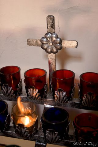 Devotion Candles and Cross at San Miguel Mission, Sante Fe, New Mexico, photo