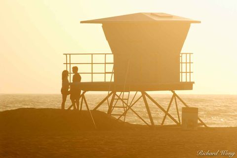 Couple About to Share a Romantic Kiss Next to Lifeguard Tower at Huntington State Beach, Huntington Beach, California, photo