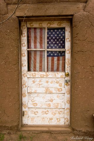 New Mexico, adobe, architecture, door, doors, entrance, flags, historic landmark, history, home, homes, indian reservation, irony, landmarks, native american, old, patriotism, red willow indians, resi