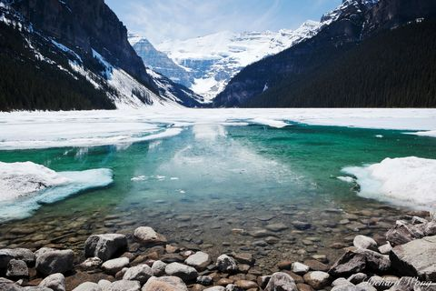 alberta, banff, banff national park, canada, canadian rockies, chilly, cold, coldness, color image, from shore, from shore point of view, from shore pov, frozen, horizontal format, ice, icy, lac louis