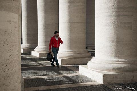Smoking Man Walking Through Piazza San Pietro in Citta del Vaticano, Roma, Italia, photo