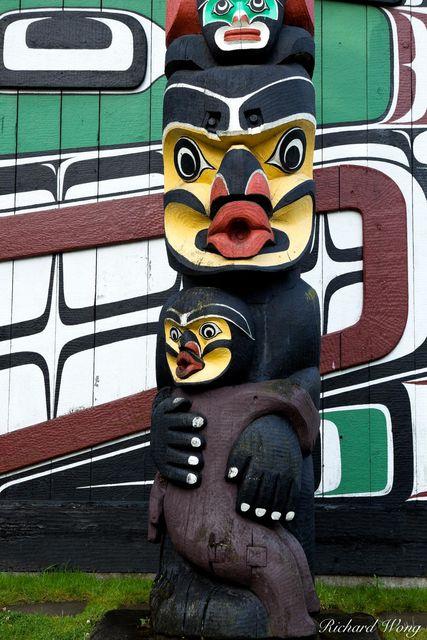 Totem Pole and Kwakwaka'wakw (Kwakiutl) Longhouse in Thunderbird Park, Victoria, B.C., photo