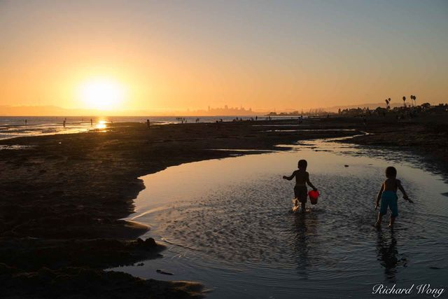 Two Kids Playing in Water at Robert Crown Memorial State Beach, Alameda, California, photo