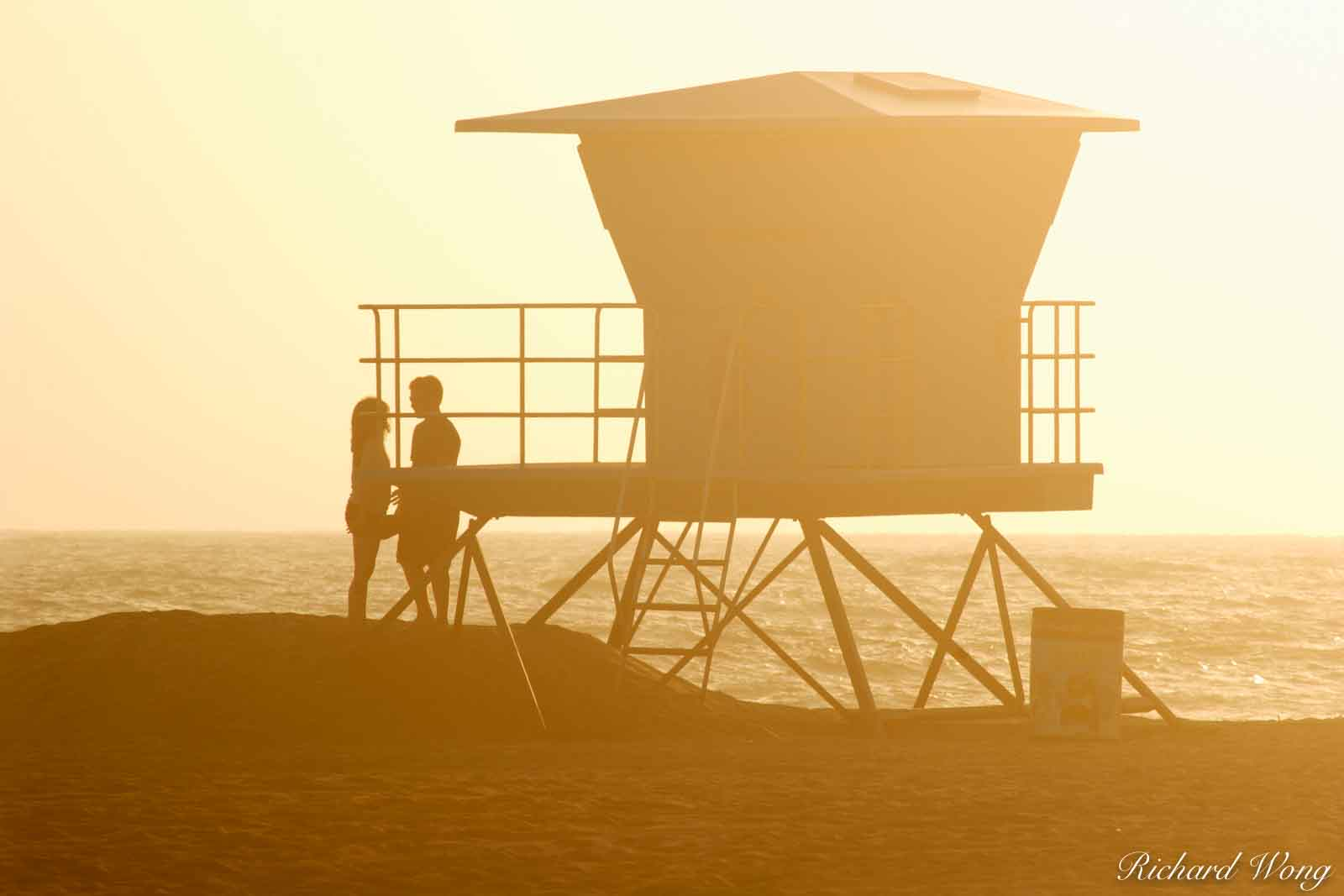 Couple About to Share a Romantic Kiss Next to Lifeguard Tower at Huntington State Beach, Huntington Beach, California, photo, photo