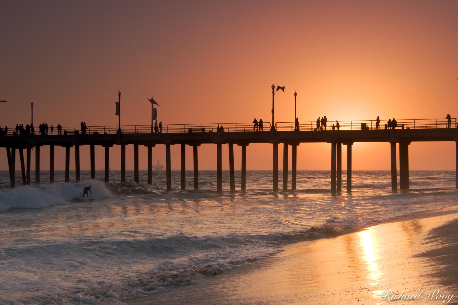 Peter Lik California Dreaming Style Photo, Surfer Riding Wave at Sunset Next to Huntington Beach Pier, California, photo