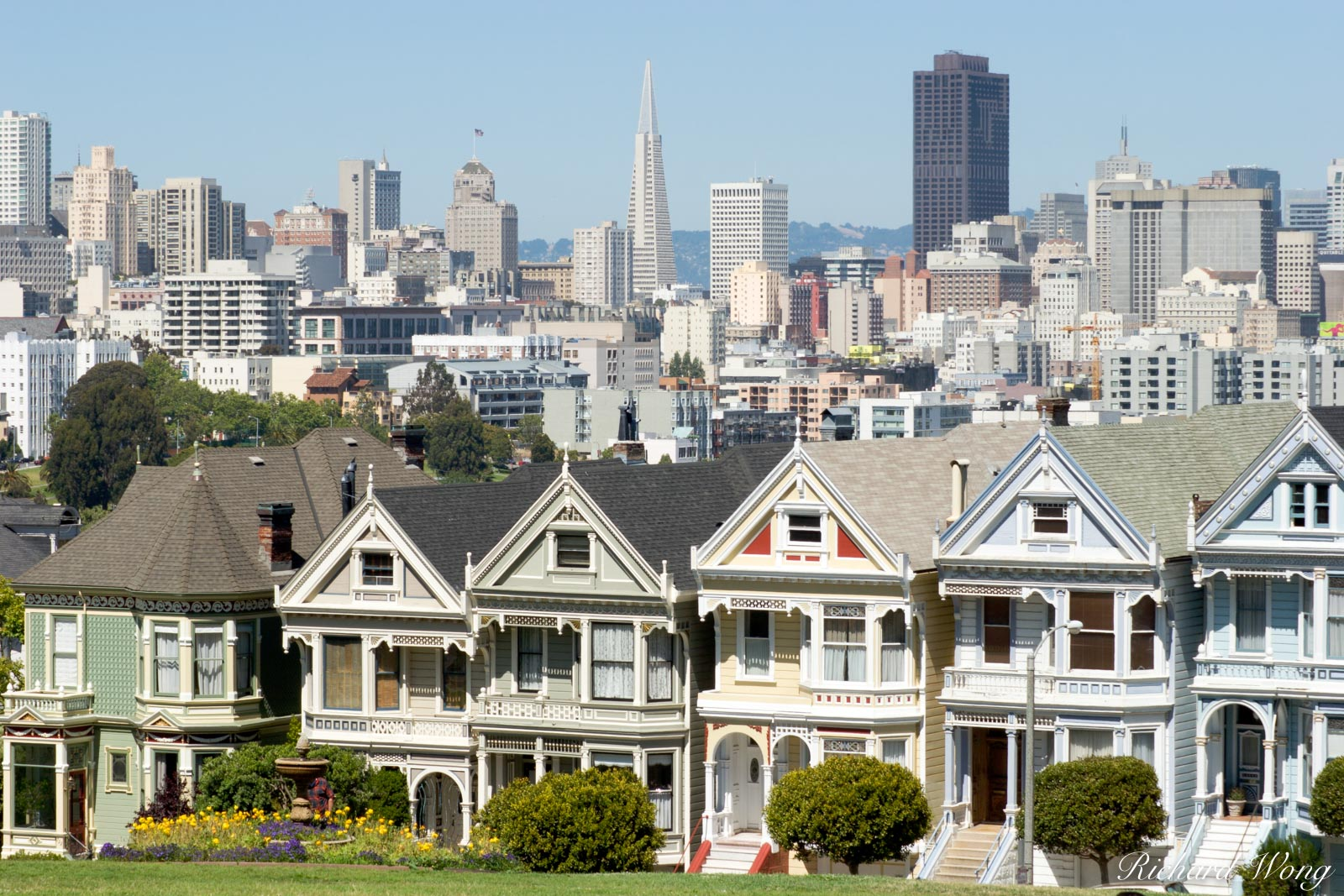 Downtown Scenic View From Alamo Square Postcard Row, San Francisco, California Perhaps the most famous Victorian homes in the...