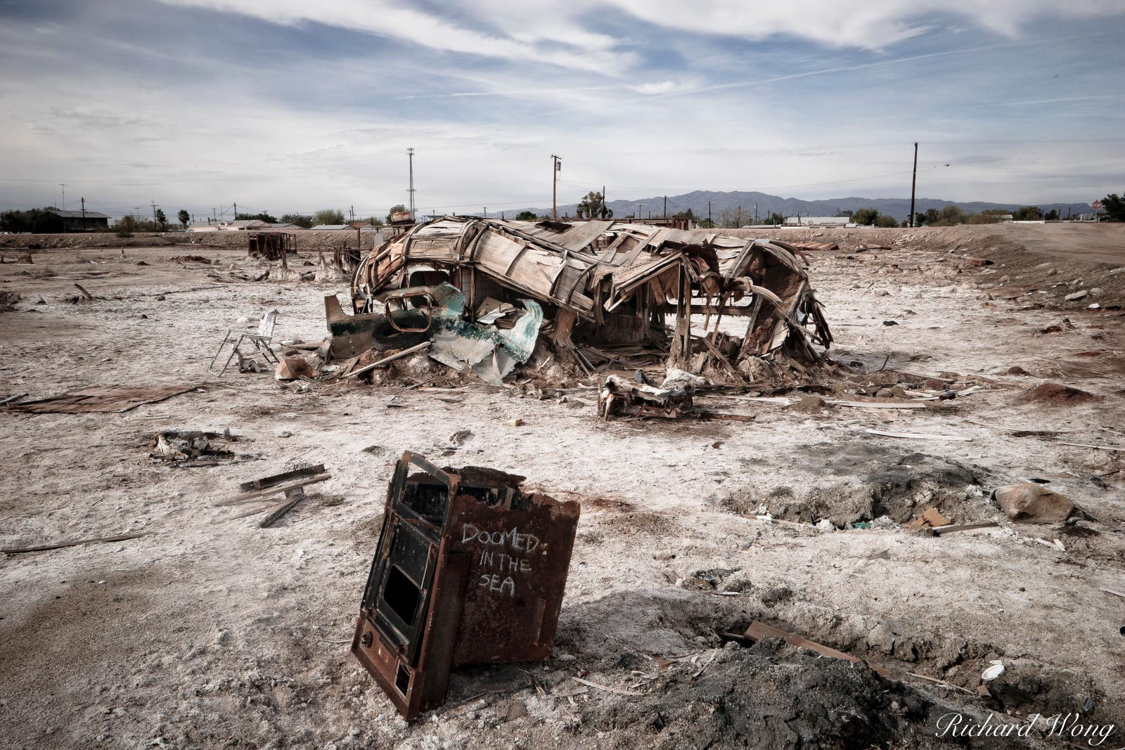 Abandoned RV Trailer Buried in Mud near Salton Sea, Bombay Beach, California, photo, photo