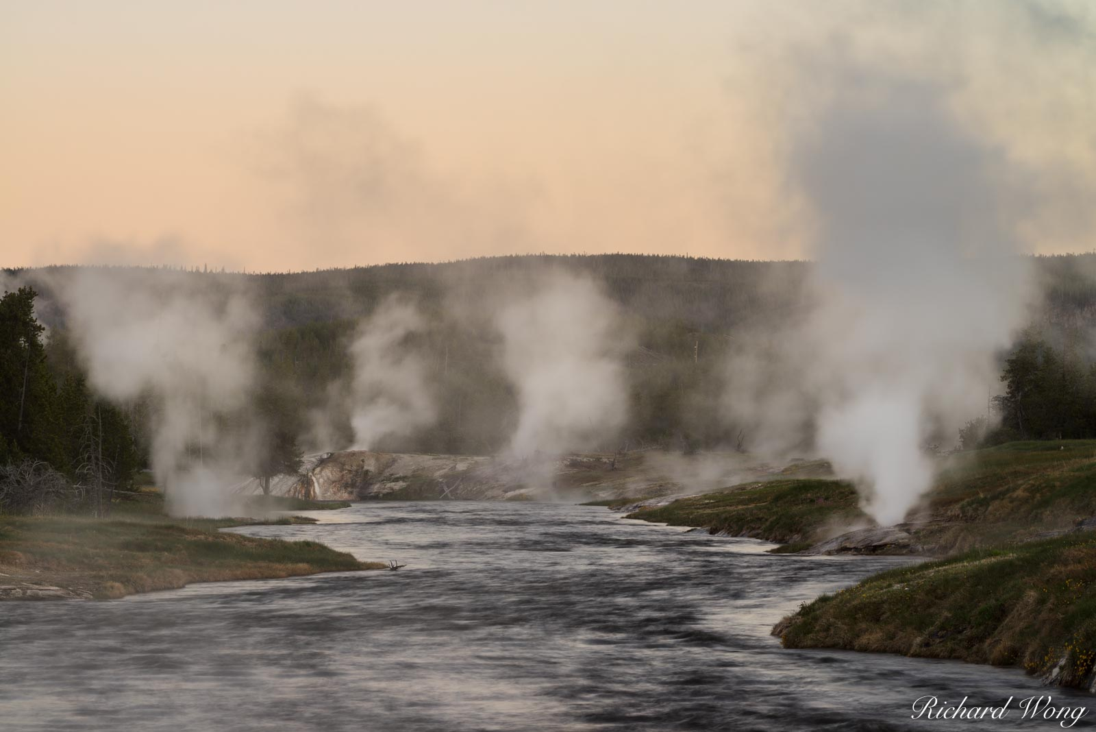 Firehole River at Dawn, Yellowstone National Park, Wyoming The Firehole River derives its name for the numerous geysers and steam...